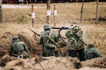 Re-enactors Dressed As German Wehrmacht Infantry Soldiers In Wor
