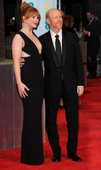 Bryce Dallas Howard and her father Ron Howard arrive for the British Academy of Film and Television Awards (BAFTA) at the Royal Albert Hall in London