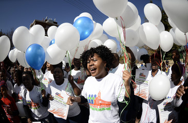 Members of the Tshwane gospel choir hold 95 white balloons to mark the upcoming 95th birthday on July 18 of ailing former South African President Nelson Mandela in Pretoria