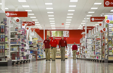 Employees walk through the new Target store in Guelph, Ontario