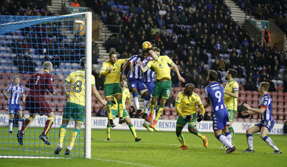 Wigan Athletic's Omar Bogle scores their first goal