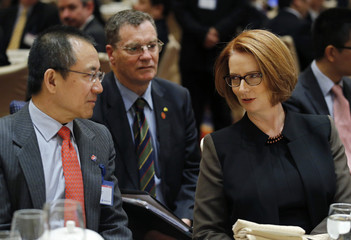 Australia's Prime Minister Gillard talks with Gao, vice chairman and president of CIC, at a welcoming lunch during the Australia China Economic and Trade Forum at a hotel in Beijing