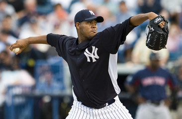 New York Yankees' starter Nova pitches against the Boston Red Sox during a spring training baseball game in Tampa