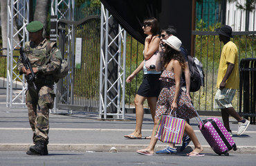 A soldier from the French Foreign Legion patrols on the Promenade des Anglais on the third day of national mourning to pay tribute to victims of the truck attack on Bastille Day that killed scores and injured as many in Nice