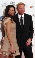 Former tennis player Boris Becker poses with his wife Lilly Kerssenberg after their arrival for the Starlite Charity Gala at the Hotel Villa Padierna in Benahavis