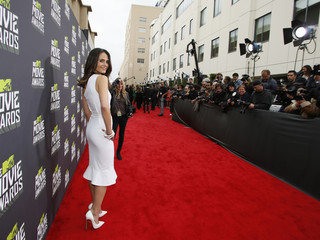 Actress Jordana Brewster poses as she arrives at the 2013 MTV Movie Awards in Culver City