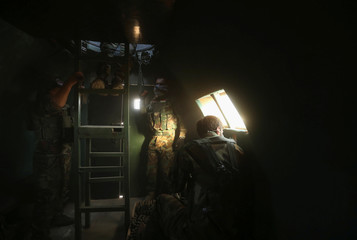 Members of the Peshmerga forces are seen inside a military vehicle north of Mosul, during an operation to attack Islamic State militants in Mosul