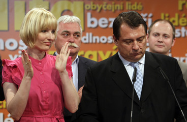 Czech Social Democrat Chairman Paroubek is applauded by his wife Petra and other party members during a news conference after preliminary results of the country's general election in Prague
