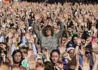 People attend an open-air meditation day headed by Hindu spiritual leader Sri Sri Ravi Shankar and organized by the Art of Living foundation in Buenos Aires
