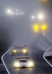 Competitors drive their cars in the rain during a warm-up session before the Le Mans 24-hour sportscar race in Le Mans