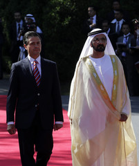 Enrique Pena Nieto and Sheikh Mohammed Bin Rashid Al Maktoum review the honour guard during an official welcoming ceremony for Al Maktoum at the Los Pinos official res