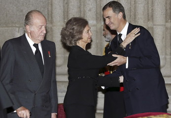 Spanish King Felipe greets his mother former Queen Sofia in front of his father former King Juan Carlos at a funeral service in San Lorenzo de El Escorial, near Madrid, Spain