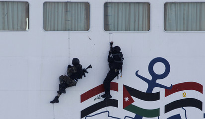 Members of the special forces use a rope ladder to board a ship during a boarding drill, part of the Eager Lion military exercise, in the coastal city of Aqaba