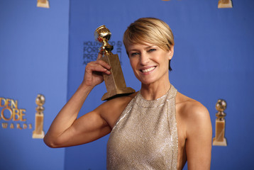 """Actress Robin Wright poses with the award for Best Actress in a TV Series, Drama for her role in """"House of Cards,"""" backstage at the 71st annual Golden Globe Awards in Beverly Hills"""