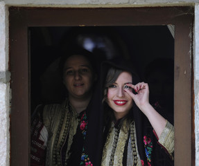 Bride Aleksandra Krstevska looks at her groom through a ring at a traditional wedding ceremony in the village of Galicnik