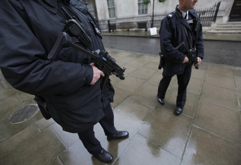 Armed police officers stand on duty in Downing Street, in Westminster, central London