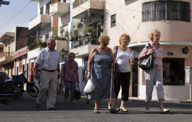 Tourists walk through the Colonial Zone in Santo Domingo