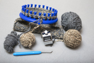 Knitting in two strands of winter warm woolen slippers on a circular loom