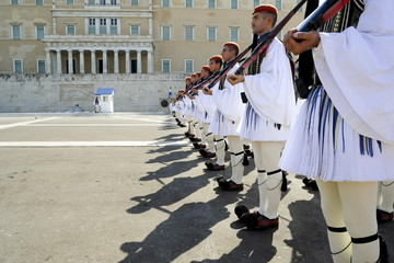 Members of the Greek Presidential Guard attend a ceremonial parade in front of the parliament building in Athens