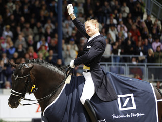 German rider Rath riding Totilas celebrates after winning the FEI Grand Prix Freestyle CDIO competition at the World Equestrian Festival CHIO in Aachen