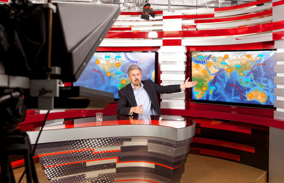 Weather forecast. A television anchorman at studio
