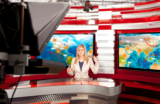 Weather forecast. A television anchorwoman at studio