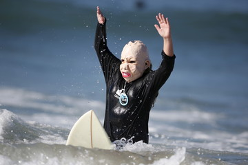 Joey Callhehan, 13, competes dressed as a baby during the ZJ Boarding House Haunted Heats Halloween Surf Contest in Santa Monica