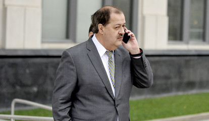 Former Massey Energy Chief Executive Don Blankenship is talking on his mobile phone as he walks into the Robert C. Byrd U.S. Courthouse in Charleston West Virginia
