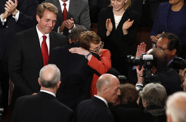 President Barack Obama hugs Representative Gabrielle Giffords before Obama's State of the Union address to a joint session of Congress on Capitol Hill in Washington