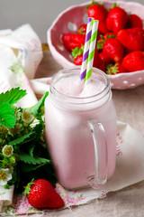 strawberry milkshake in mason jar.style vintage.