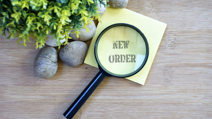 Ornamental trees, stones Small, magnifying glass, sticky note with text new order