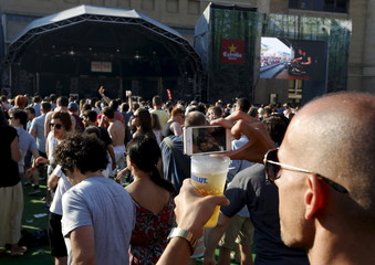 A man takes a video during the Sonar Festival in Barcelona