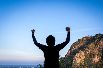 Men raised their arms up the sky. He was delighted in his success.