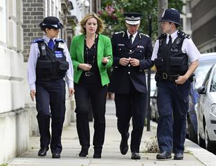 Britain's Home Secretary Amber Rudd walks with Metropolitan Police Commissioner Sir Bernard Hogan-Howe (2nd R) in Westminster, London