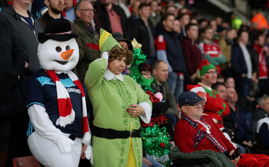 Middlesbrough fans in Christmas fancy dress look dejected at the end of the match