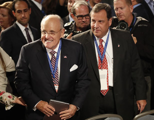 New Jersey Governor Christie and former New York City Mayor Giuliani take their seats ahead of the start of the first presidential debate in Hempstead