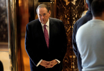 Former Arkansas Governor Mike Huckabee listens to reporters' questions as he arrives to meet with U.S. President-elect Donald Trump at Trump Tower in New York City