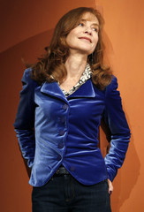 """French actress Huppert poses during a photocall for her movie """"Mon Pire Cauchemar"""" at Rome Film Festival"""
