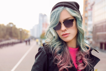 Trendy ideas.Young woman with mint color accent in hairstyle outdoor