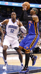 New York Knicks' Anthony shoots as Orlando Magic's Howard defends him during their NBA basketball game in Orlando