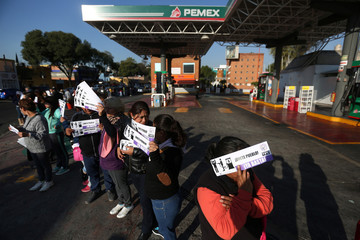 Protesters block the entrance to a gas station as they take part during a demonstration at Tlalpan avenue against the rising prices of gasoline enforced by the Mexican government, in Mexico City
