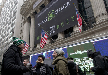 Patrons receive free breakfast from Shake Shack in front of New York Stock Exchange to celebrate the company's IPO