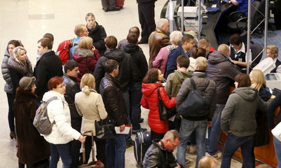 Passengers, whose flights to Egypt were suspended, gather at an information desk of Domodedovo airport outside Moscow