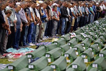 Bosnian Muslims pray during a mass funeral for newly identified victims from the Srebrenica massacre, at Potocari Memorial Center, near Srebrenica