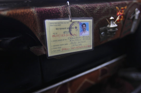 ID badge of taxi driver is pictured inside a Premier Padmini taxi at a workshop in Mumbai