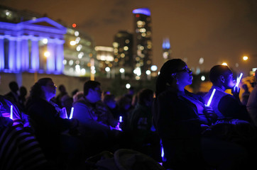 Chicago Police officers and family members attend the 10th Annual Chicago Police Memorial Foundation's Candlelight Vigil in Chicago