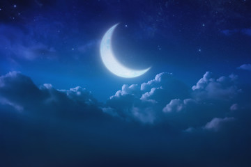 half blue moon behind cloudy on sky and star at night. Outdoors at night. lunar shine moonlight over cloud at nighttime with copy space background for headline text and graphic design.