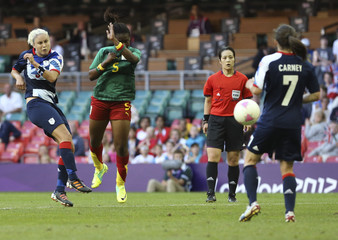 Britain's Stephanie Houghton scores a goal against Cameroon during their women's Group E football match at the London 2012 Olympic Games
