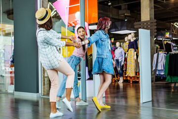 cheerful multicultural hipster girls in shopping mall, friends shopping concept