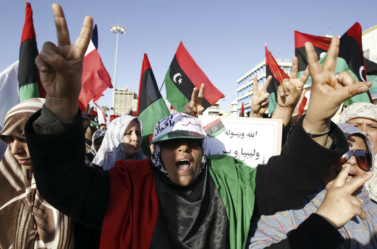 Women shout slogans against Libyan leader Muammar Gaddafi during a demonstration in Benghazi